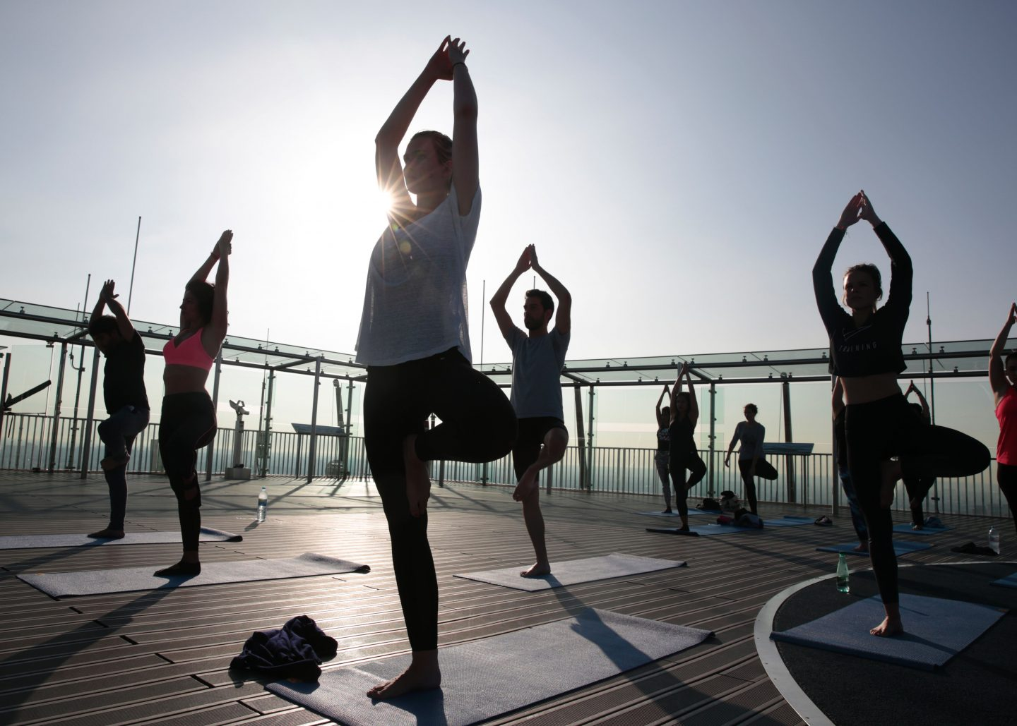 People are doing a yoga session in the sun. Yoga; Workout; Performance; adidas; GamePlan A; Fitness; Relax; Balance; Mindset