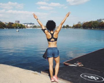 Runner doing a victory pose in front of a lake. Adrienne London, Fitness Blogger, adidas, GamePlan A, adidas Runners, London