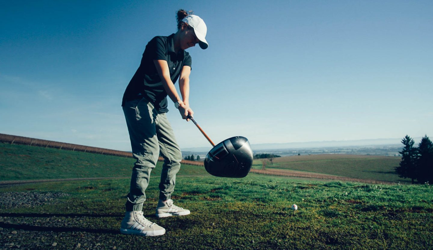 A women plays golf in nature, GamePlanA, adidas, golf