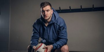 Rugby player Sam Warburton sitting on a bench in a locker room holding a rugby ball in his hands, interview, leadership, adidas, GamePlan A,