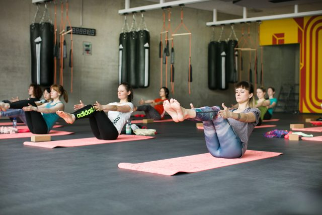 Women doing yoga in a class at adidas HQ. Fitness class-adidas-GamePlan A-gym, goal-setting, business, fitness, self-improvement