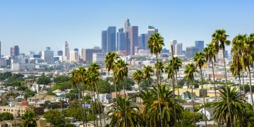 Los Angeles, California, USA downtown skyline and palm trees in foreground, adidas, communities, corporate social responsibility, youth, sports