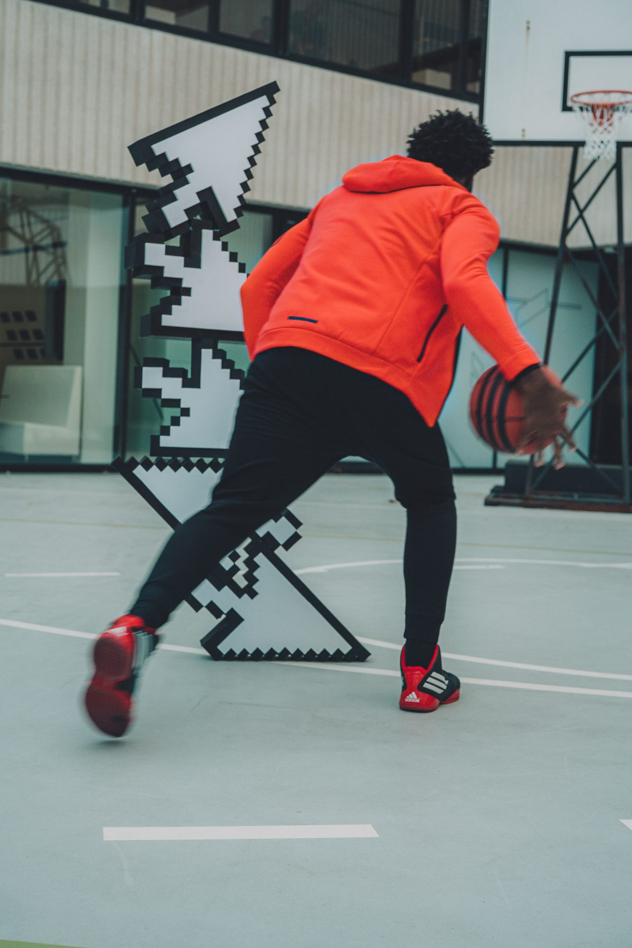 Man playing basketball against mouse cursors. adidas, HereToCreate, Basketball, adidas employee, Digital, IT, Analytics, teamwork, mindset, strategy