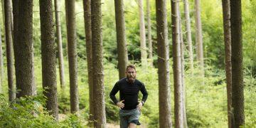 A man runs through a forest. running, fitness, outdoors, nature.