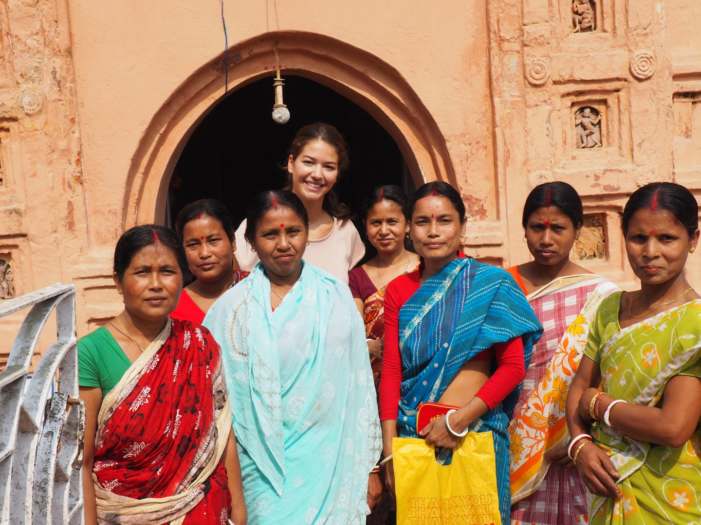 A group of woman stand together wearing traditional Indian clothing. family, culture, tradition, India