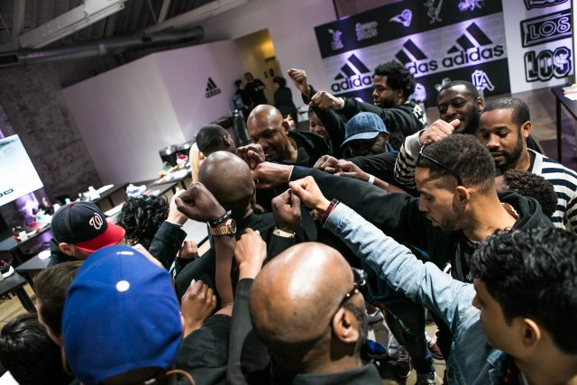 A group of men fist pump the air. team, achieve, accomplishment,