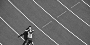 Tired runner laying on track. track, athlete, defeat, tired, sports