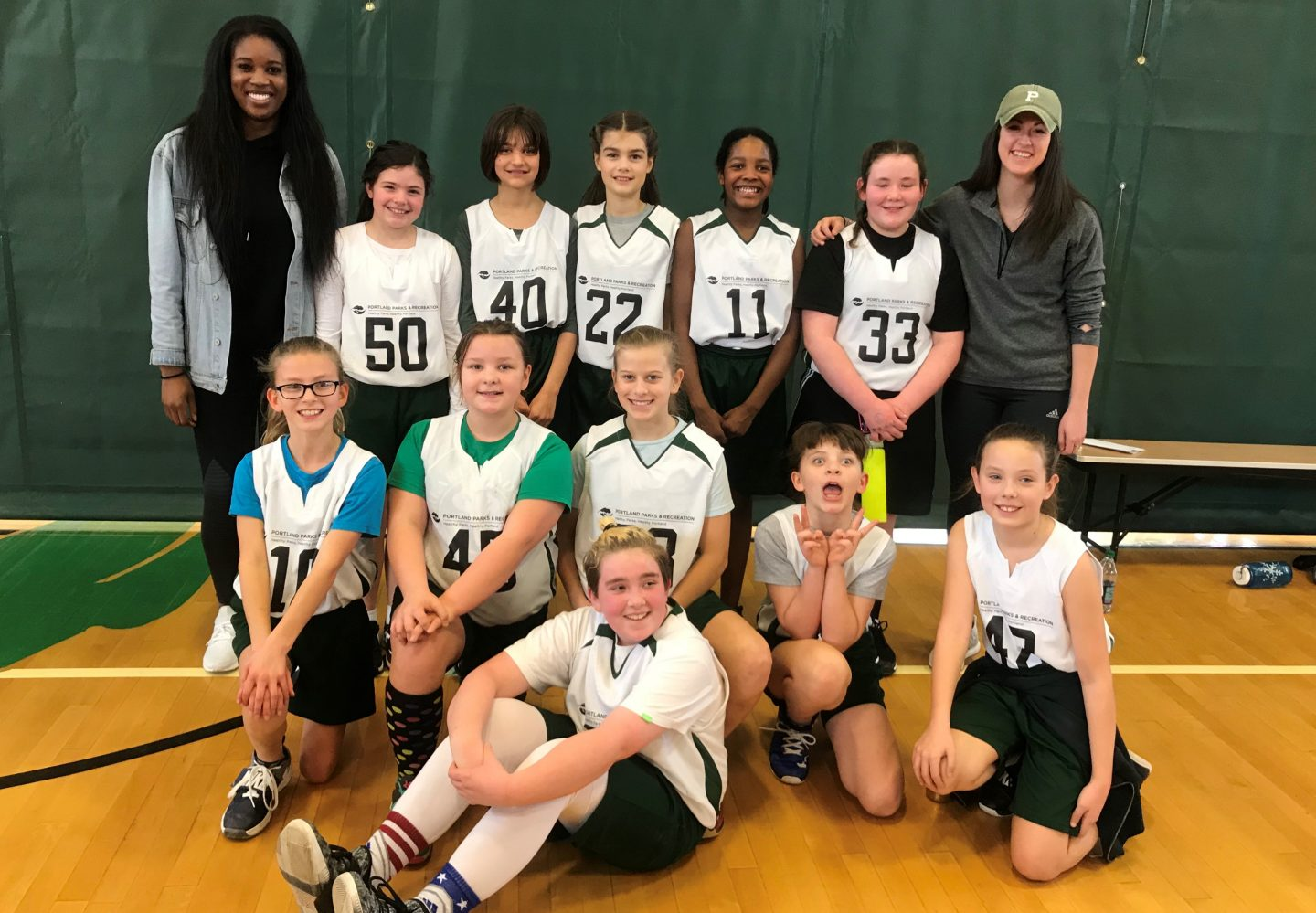 An all girls basketball team take a team photo together after a training session. team, basketball, sports, activity, teamwork