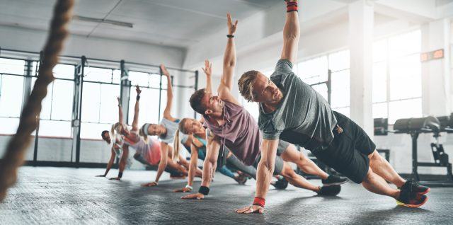 Shot of a fitness group working out at the gym. workout, fitness, sweating, gym, teamwork