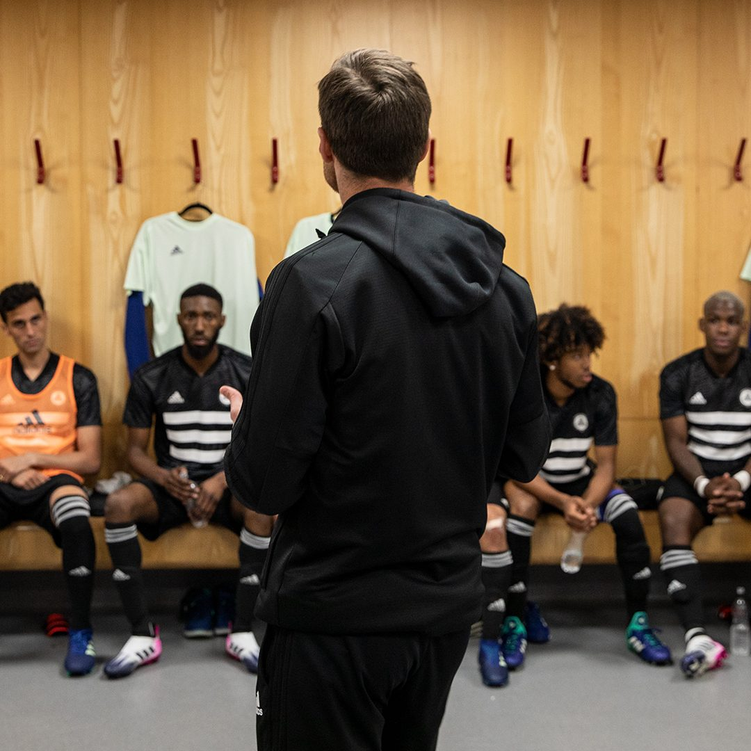 The Tango Squad team sits in anticipation in the locker room before a big match. football, Tango, FC, locker room, team