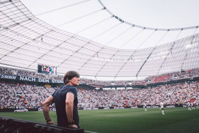 Germany national team coach Joachim Löw standing at the sideline watching his team play in the stadium. Football, GamePlan A, team, success, 2018 FIFA World Cup Russia, leadership, World Champions
