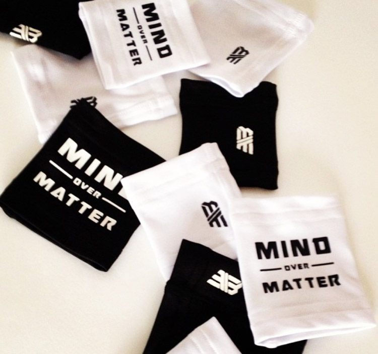 A black and white sports band says to put mind over matter.product, mind, thought, matter, band