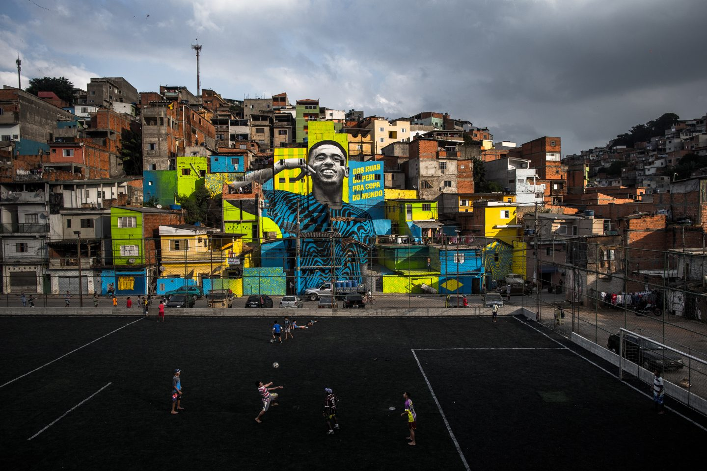 A mural fills several houses in the neighborhood with a portrait of Gabriel Jesus in Sao Paulo. mural, Brazil, Gabriel Jesus, soccer