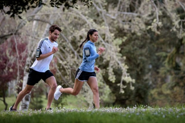 Woman and man running in a park. adidas, GamePlan A, Runtastic, team building, lifestyle