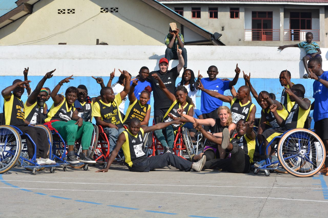 Group picture of an African wheelchair basketball team cheering. A poster in one of our office gyms encouraging colleagues to join our fundraising effort.