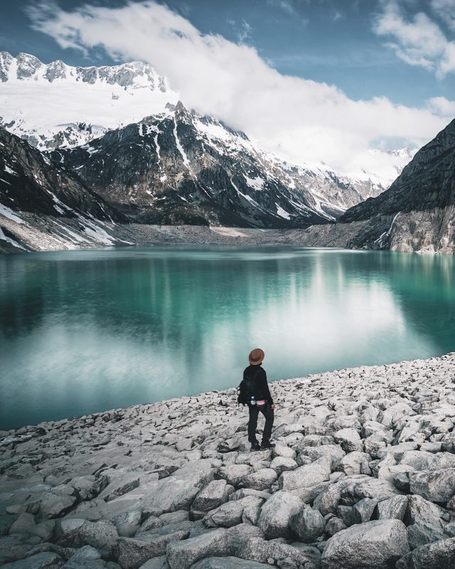Man Standing On Rock By Lake Against Sky. nutrition tips, healthy nutrition, fitness, outdoor, hiking, food, GamePlan A