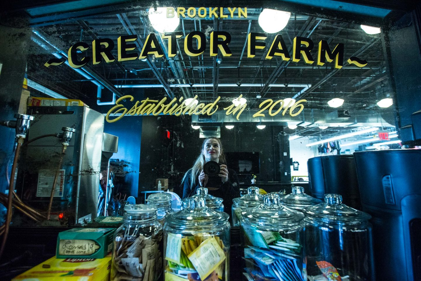 Woman taking a selfie in the mirror at the bar of the adidas Brooklyn Creator Farm in Brooklyn, New York, mirror selfie, bar, creative spaces, creativity, creative work spaces, Brooklyn, New York City, adidas, GamePlan A