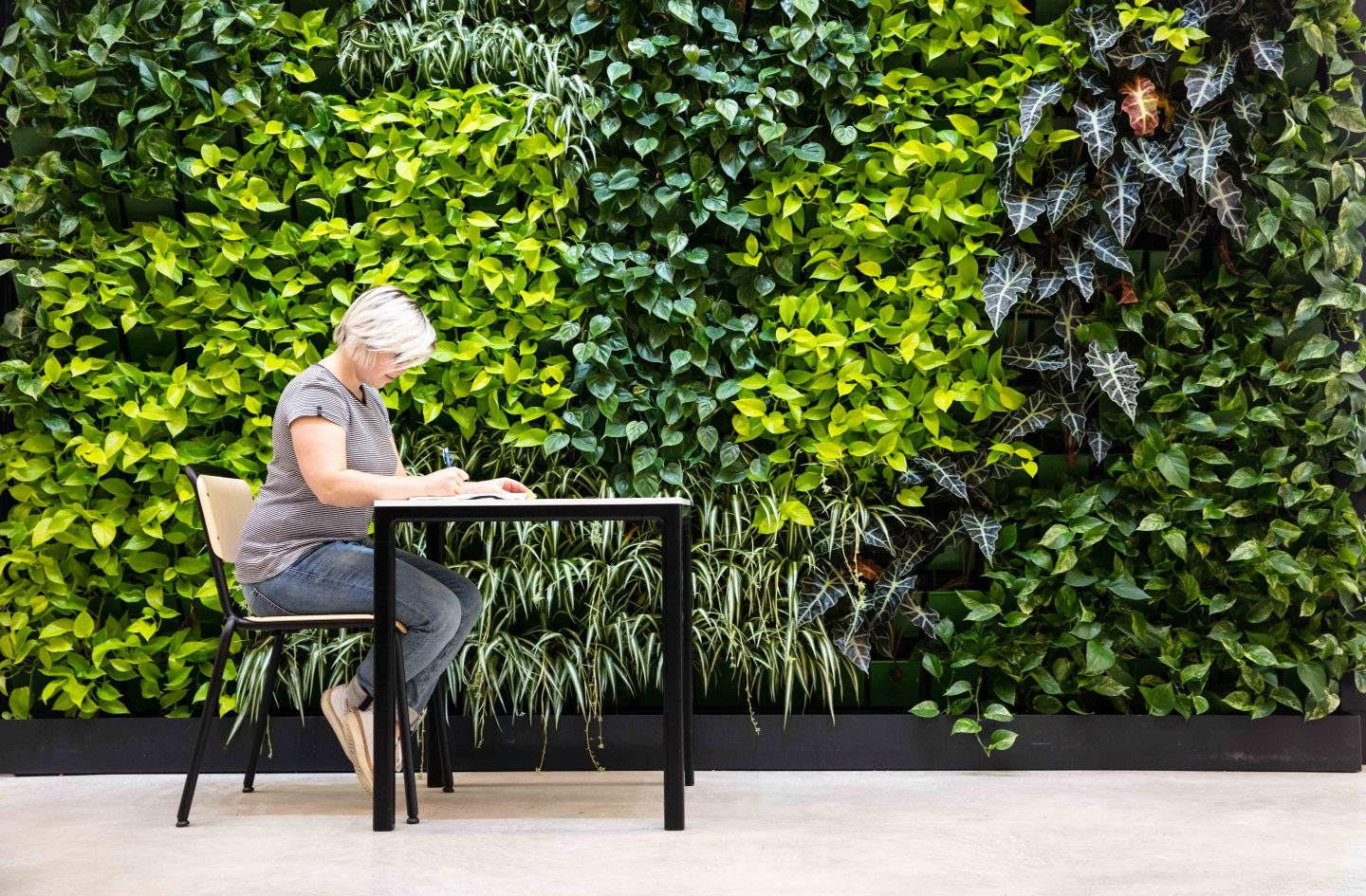 Woman focused and writing diary at work desk, work environment, healthy work place, healthy atmosphere, habits, routine, logging, consistency, adidas HQ, Herzogenaurach, GamePlan A