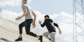 Guys running up-hill on concrete underground in sports clothes, urban sports, urban athletes, workout, running, sky is the limit, goals, achievements, ambition, Reebok, GamePlan A