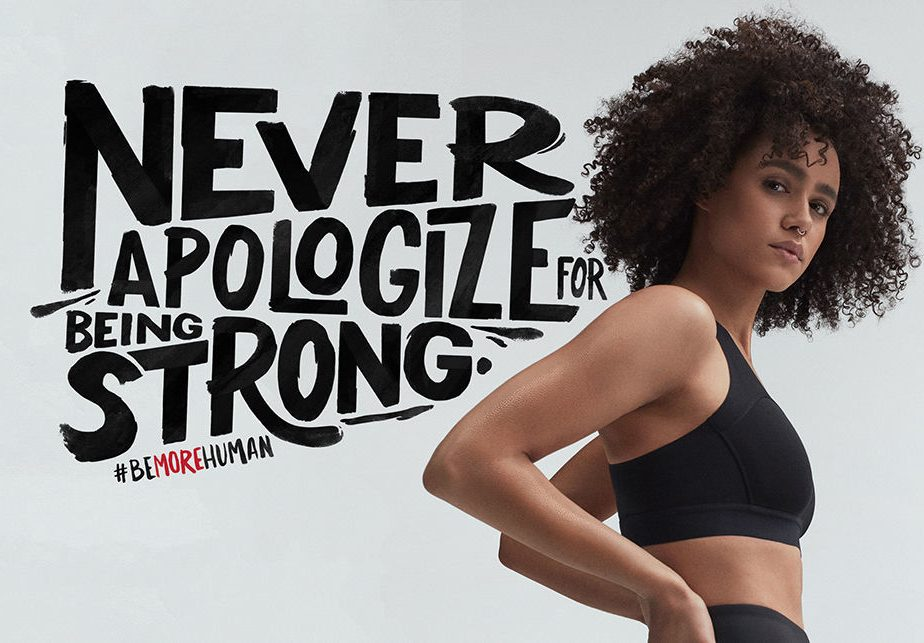 Woman black sports clothes looking confident and strong with hands on her hips, never apologize for being strong, Nathalie Emmanuel, actress, be more human, feminism, strong, inspiration, girl, Reebok, GamePlan A