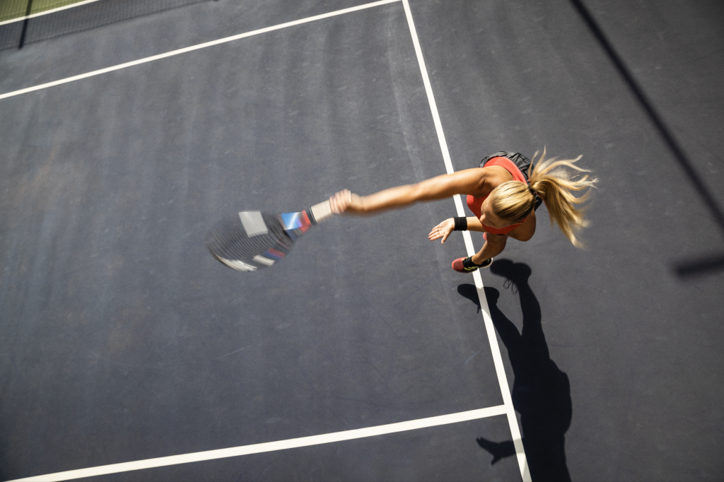 Blonde girl swinging a tennis racket on a tennis court during a game, tennis player, woman, sports, sportswoman, active, GamePlan A