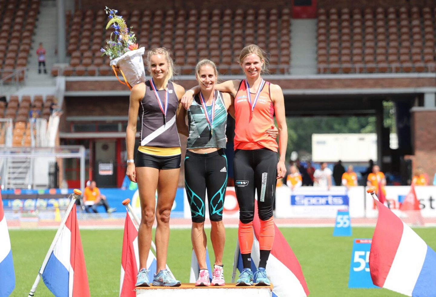 Three young athletes standing together on the winners' rostrum during an award ceremony. winning, setbacks, goal setting, achieving success, GamePlan A