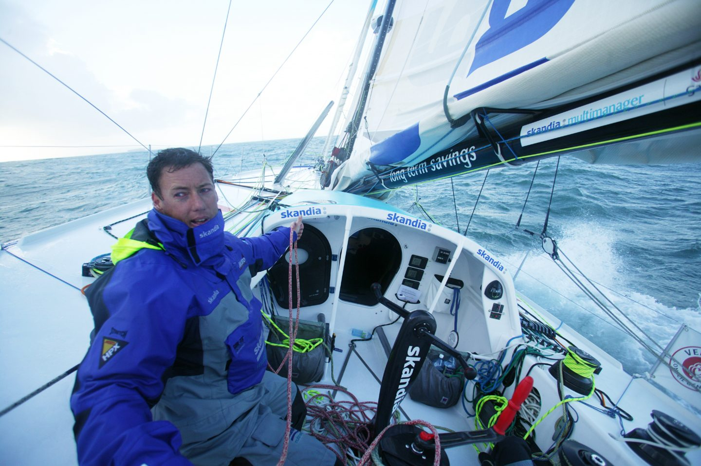 A single sailor sitting in his sailboat steering. Nick Moloney, sailing, ocean athlete, career, competition, success, preparation, mindset, GamePlan A