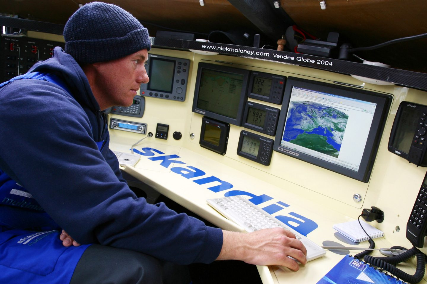 A sailor sitting in front of screens and navigations. Nick Moloney, Skandia, sailing, career, success, preparation, mindset, GamePlan A