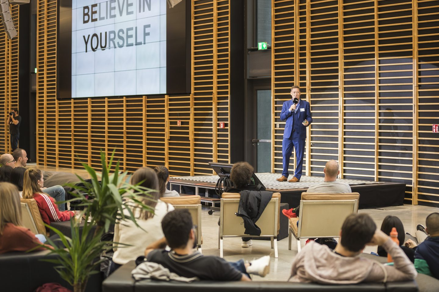 A man standing on stage and giving a speech at the adidas HQ. Nick Moloney, career, sailor, success, mindset, motivation, preparation, GamePlan A
