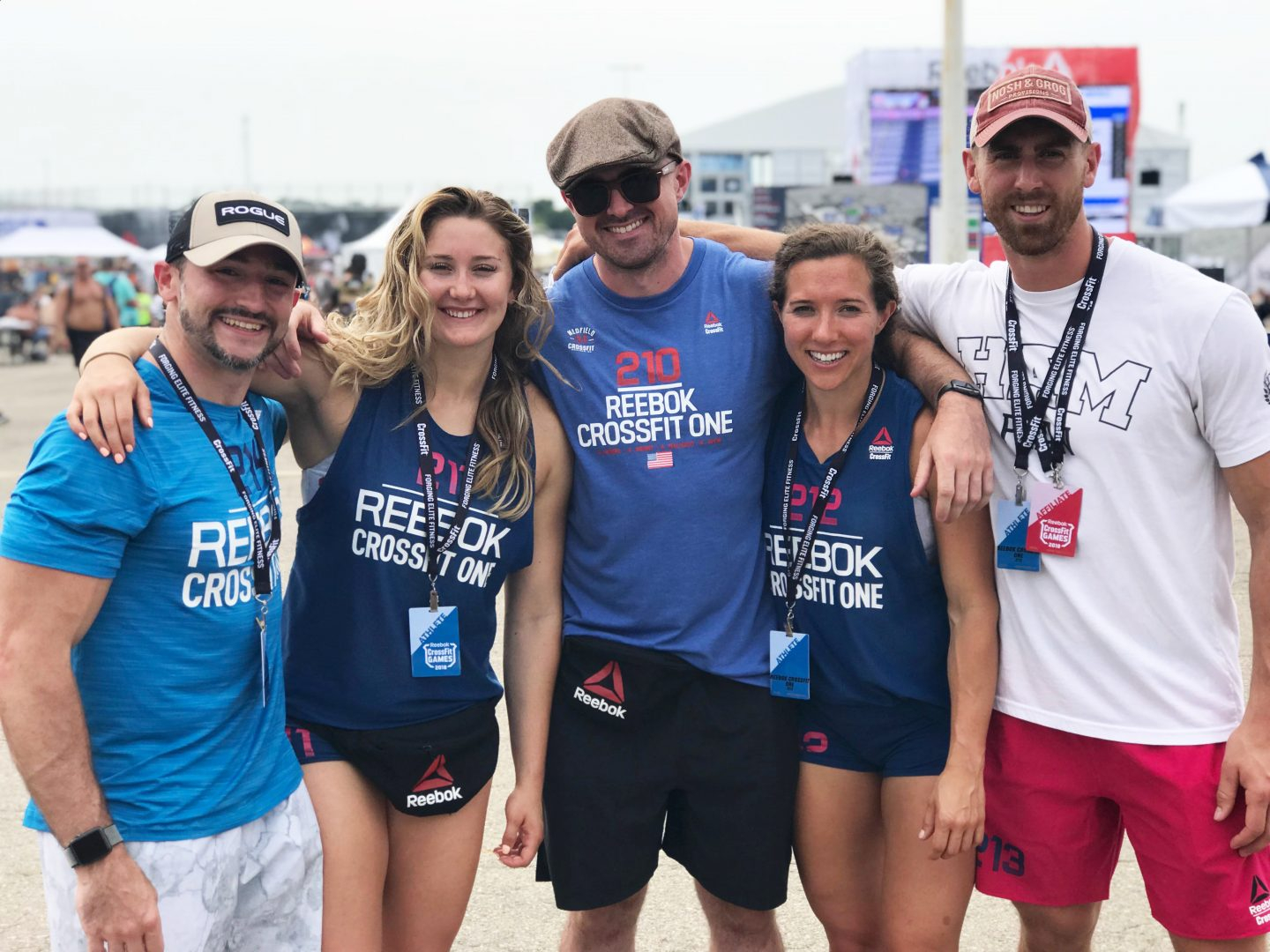 A group of three men and two women in CrossFit Gear are smiling into the camera. leadership, team, teamwork, sports, fitness, motivation, Reebok, GamePlan A