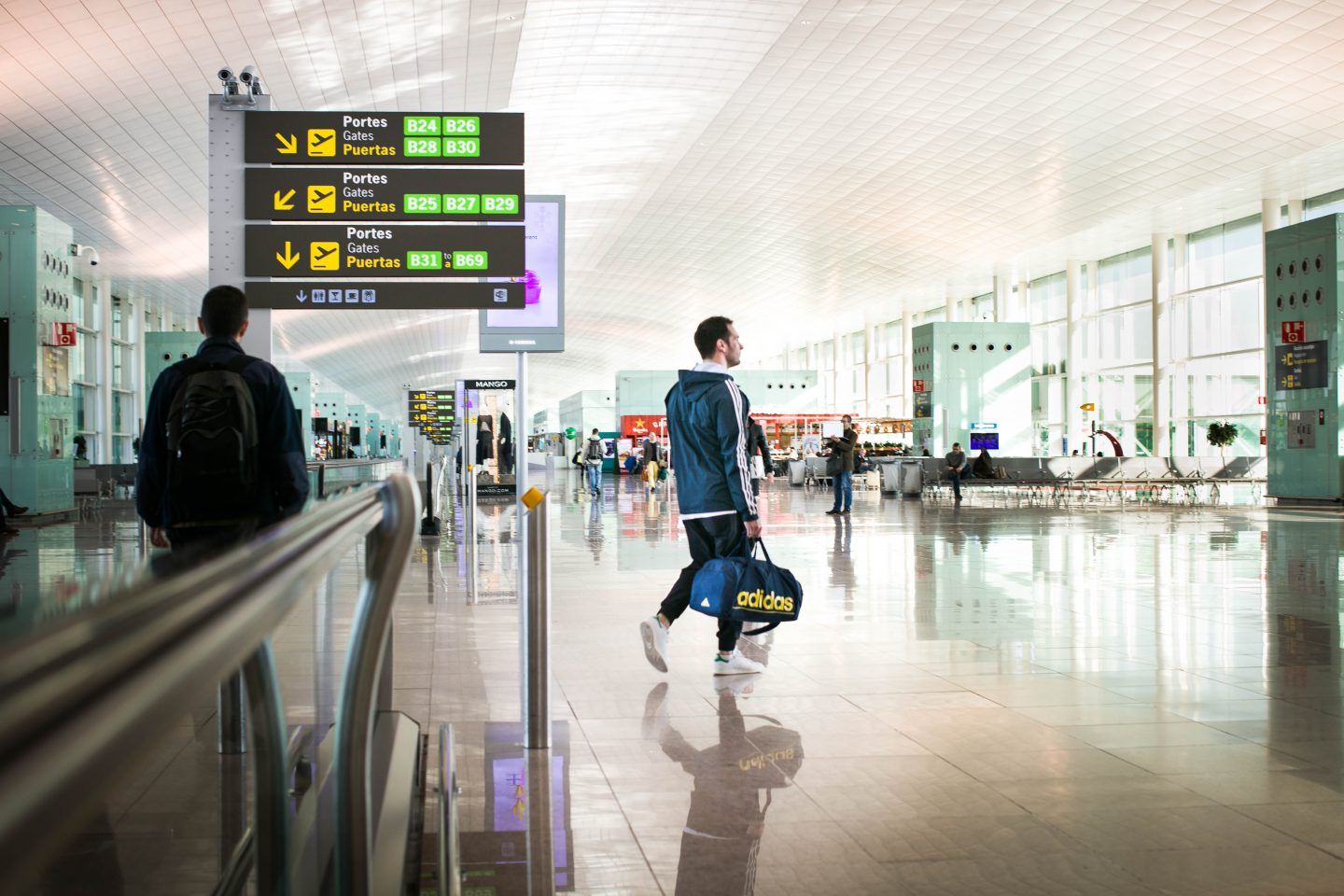 An adidas employee walking at the airport. Relocation, travel, international, working abroad, GamePlan A