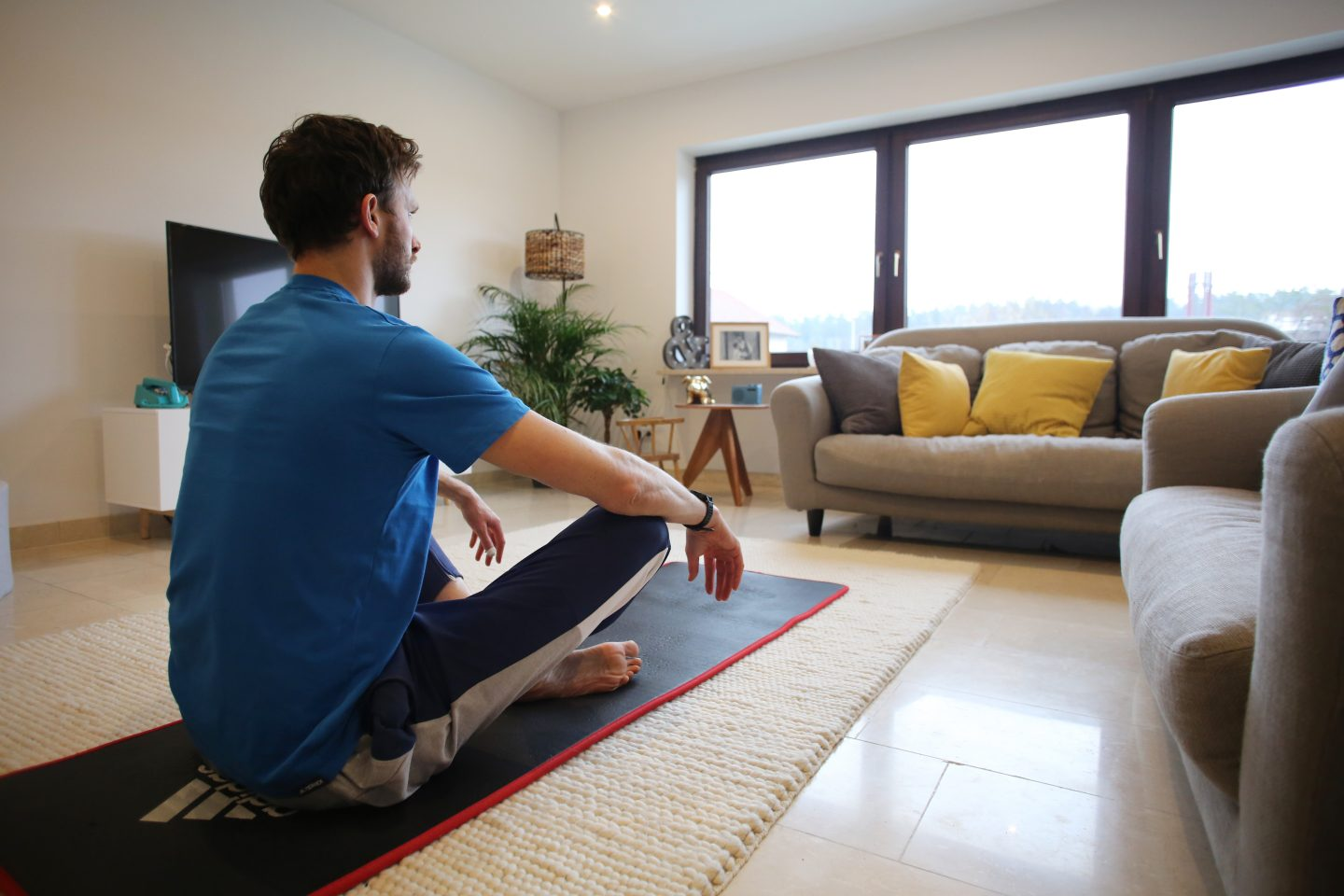 A guy meditating on his yoga mat at home. relaxing, mind training, sleep, meditation, GamePlan A