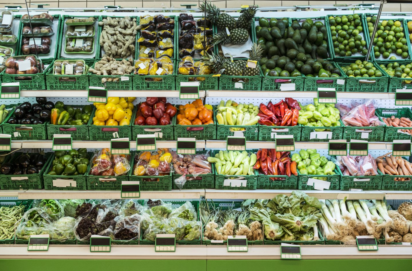 Stand with fruits and vegetables in the supermarket. Nutrition is very important when running a marathon. GamePlan A
