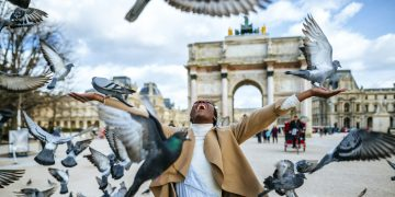 woman celebrating with doves flying around her
