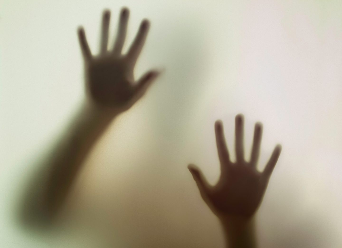 Hands viewed from a smoky glass