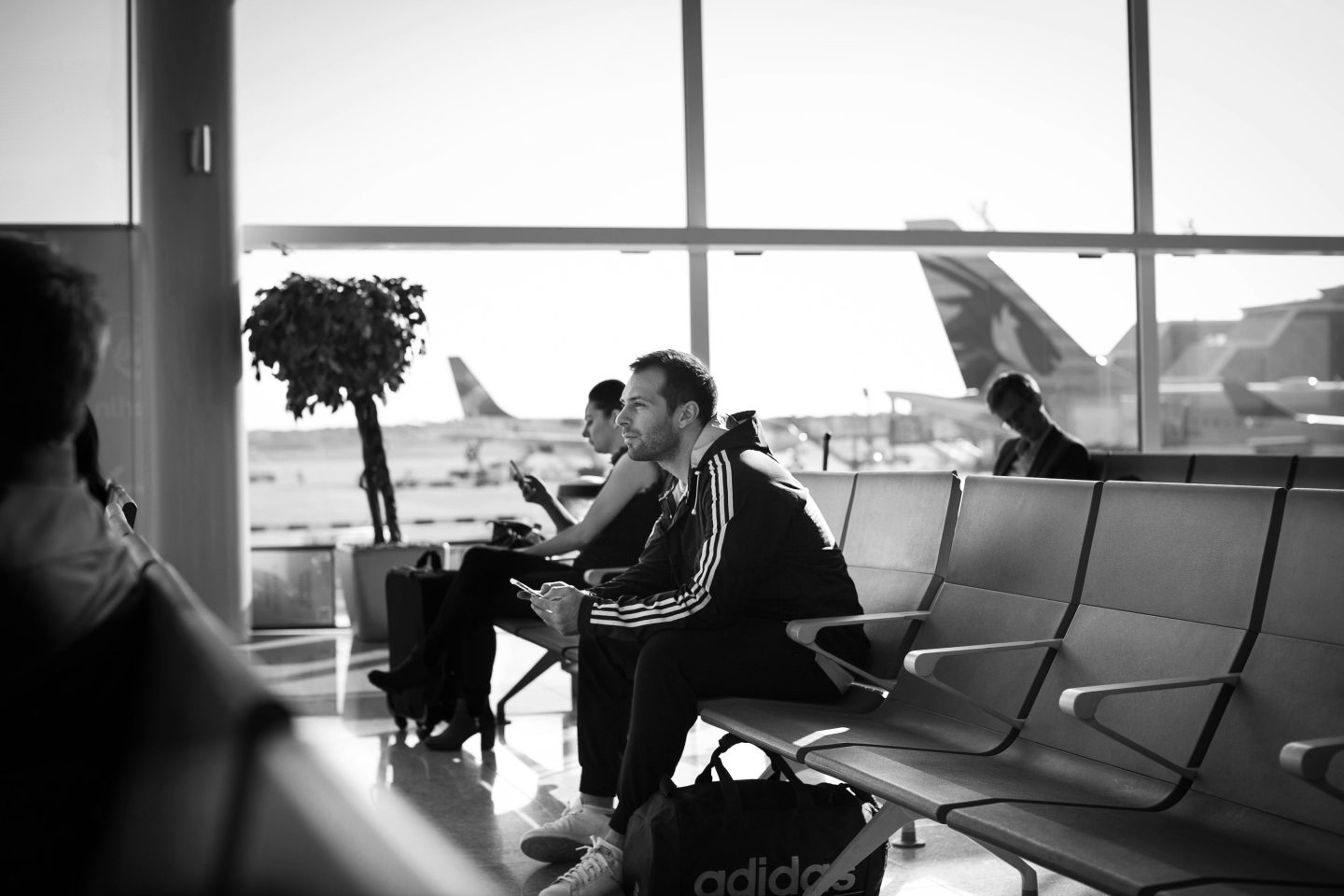 Man waiting at the airport for his flight   Fear of change