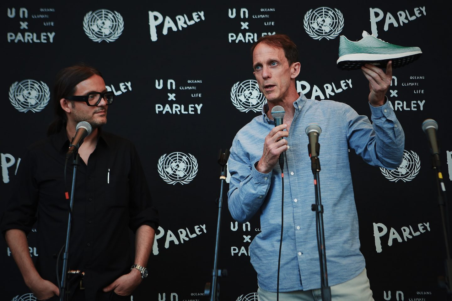 Eric Liedtke showcasing the first adidas Parley shoe standing next to Cyril Gutsch, founder of Parley for the oceans | Sustainability