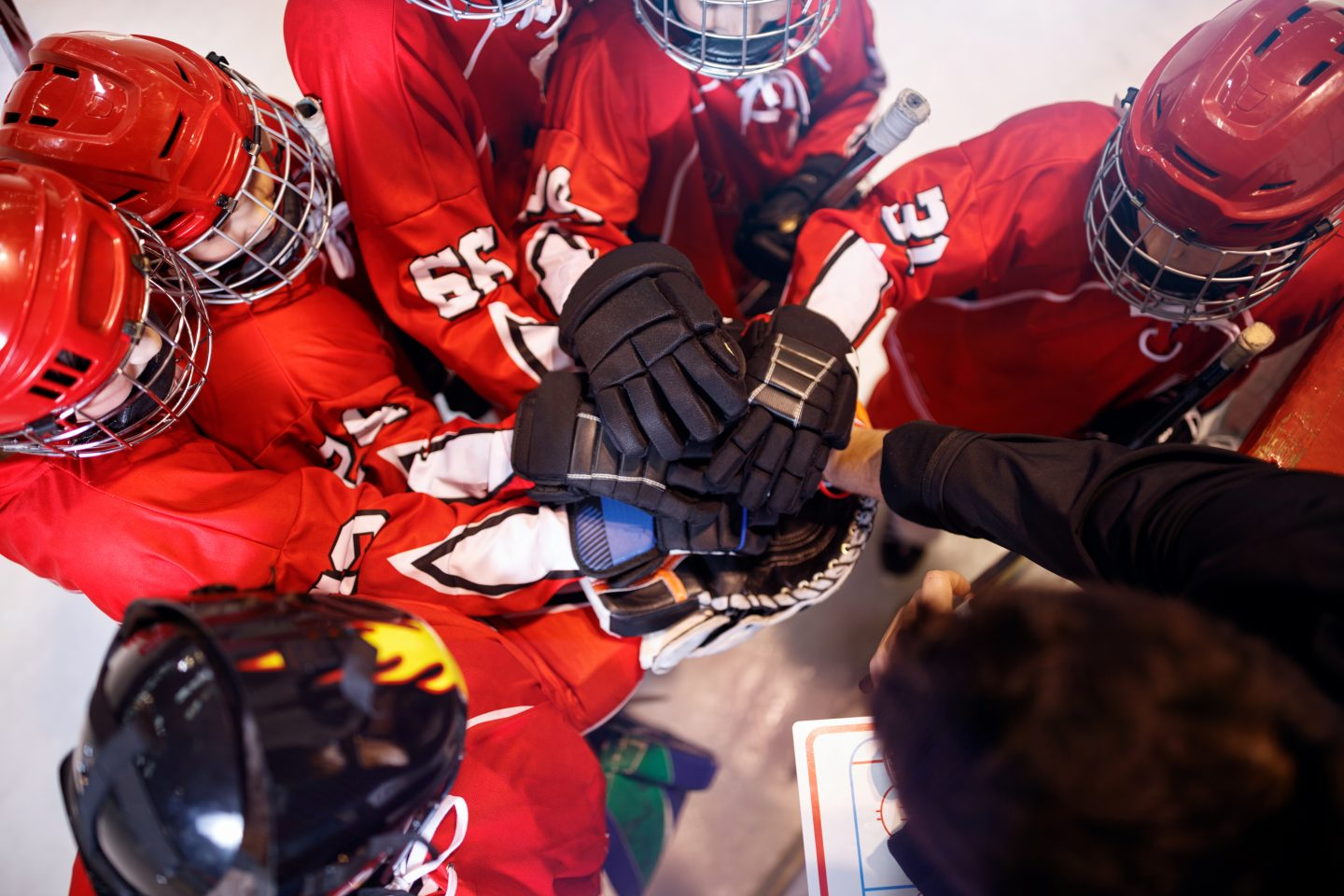 Hockey team huddle. | Coaching