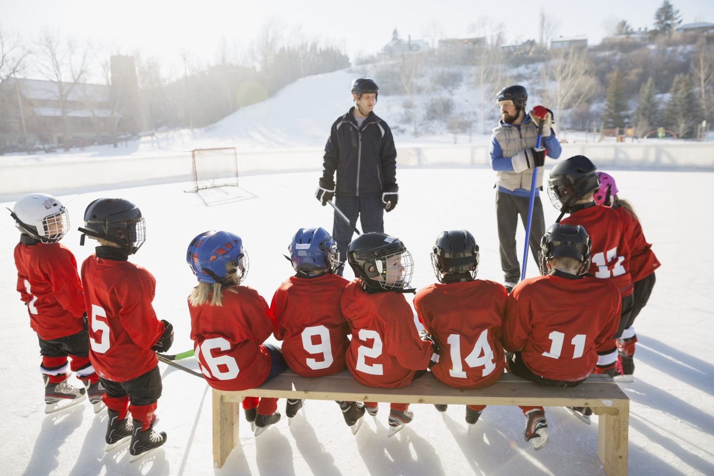 Coaches and ice hockey team on rink | Coaching