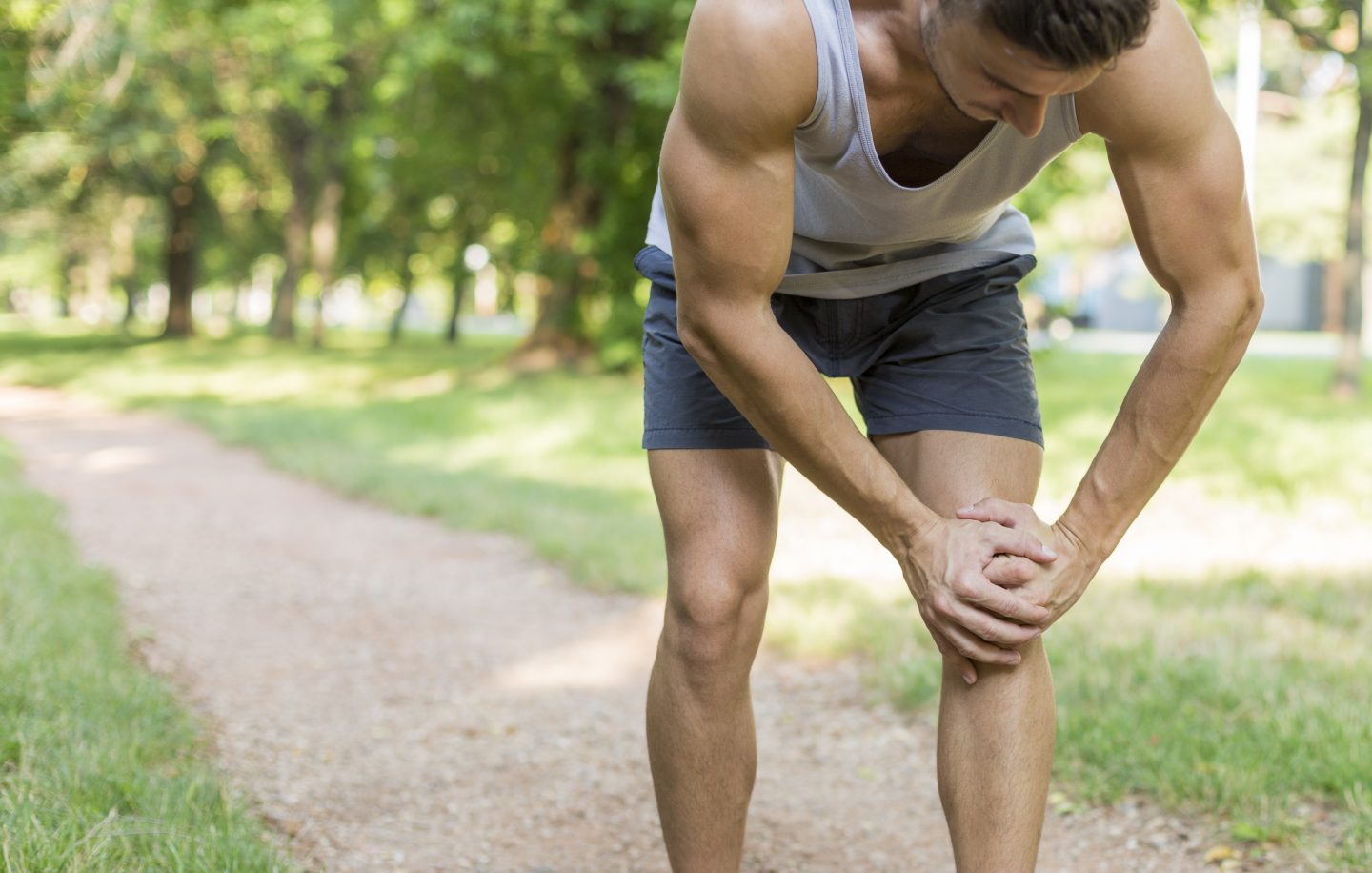 Male runner suffering with pain on sports running knee injury. Sport person often have injury. | Running injury