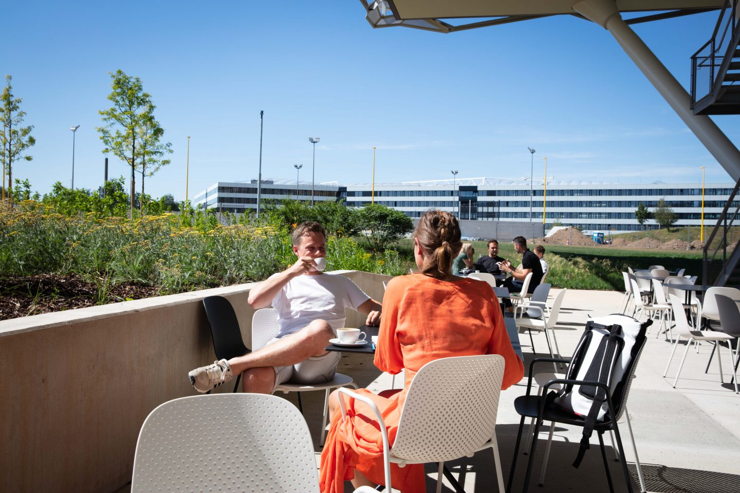 Two adidas employeeshaving having a coffee break on the terrace of the adidas Halftime building at the World of Sports in Herzogenaurach