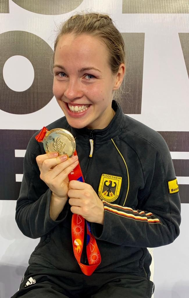 German femal boxer Ornella Wahner smiles broadly as she clutches her World Championship Gold Medal. Gamplan A.