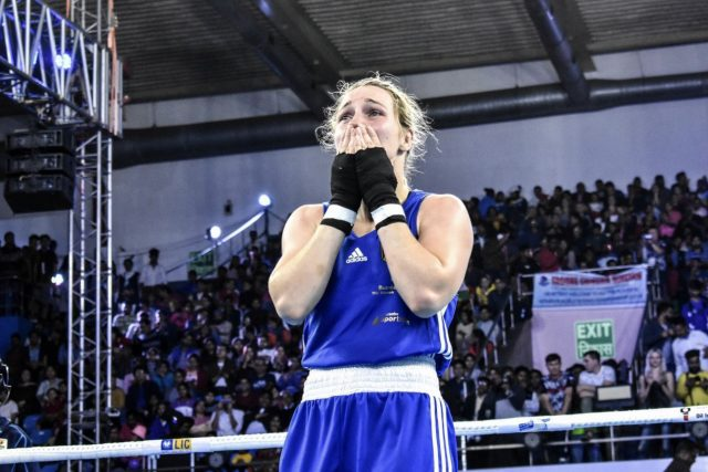 Female boxer Ornella Wahner holds her face in shocked joy as her victory is announced. Gameplan A.