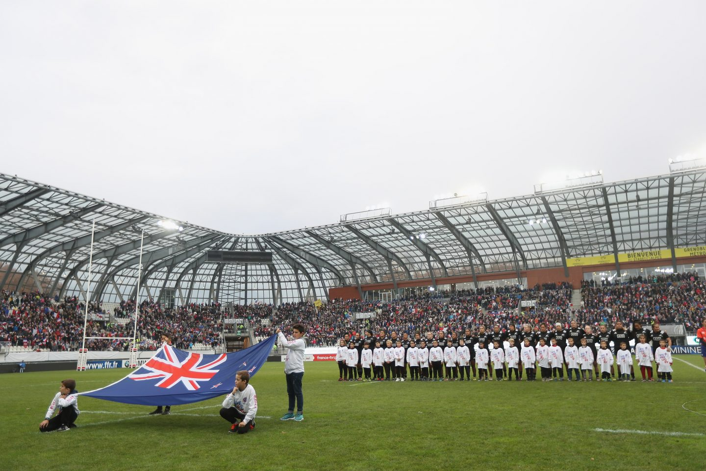 GRENOBLE, FRANCE - NOVEMBER 17: The Black Ferns stand for their National Anthem during the Womens International match between France Women and the Black Ferns at the Stade des Alpes on November 17, 2018 in Grenoble, France.   women's rugby