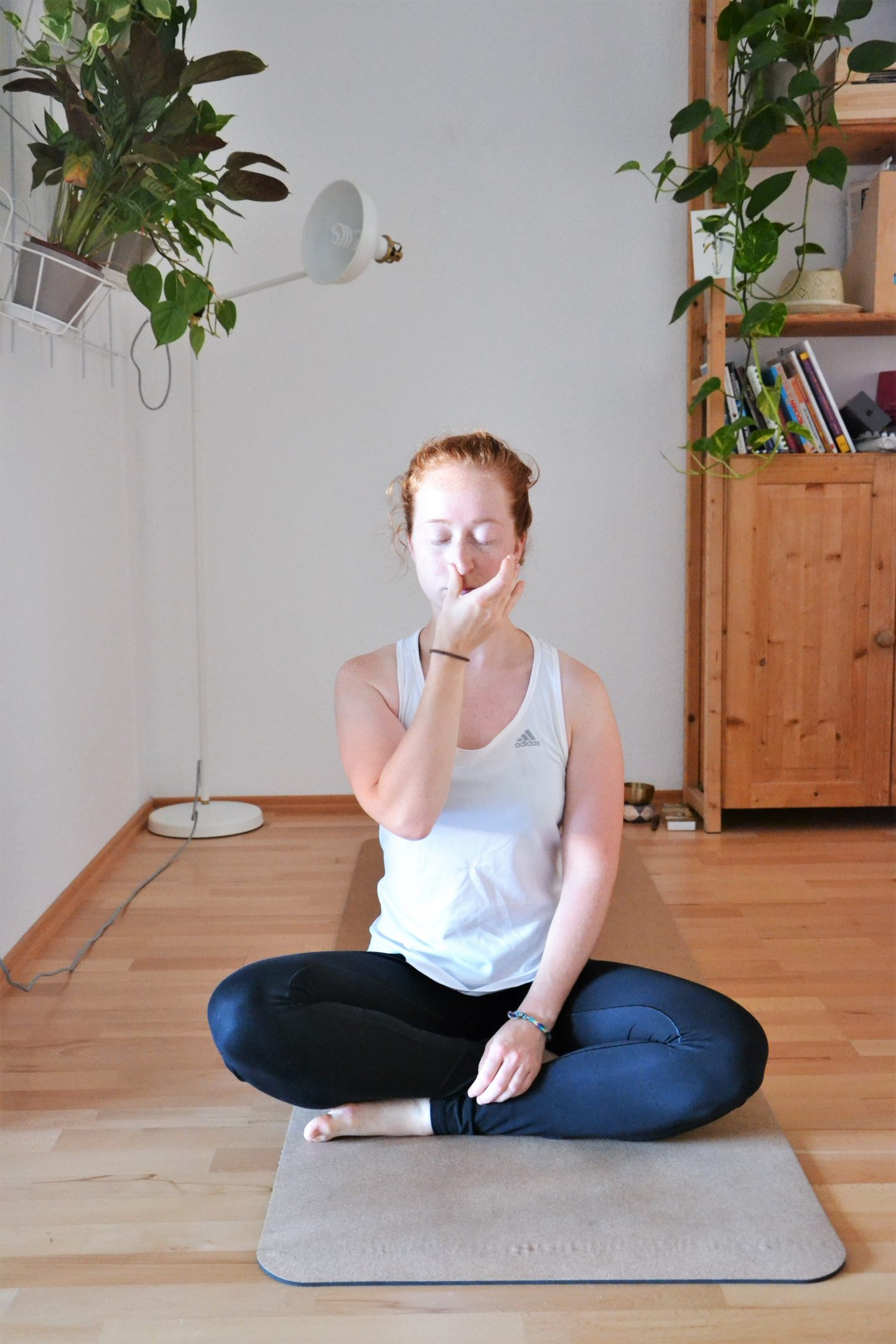 Woman practicing alternate nostril breathing. Breathing techniques, focus, summer, GameplanA