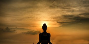 YOGA Silhouette woman sitting area meditating