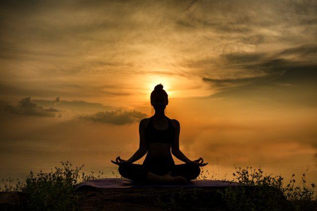 YOGA Silhouette woman sitting area meditating