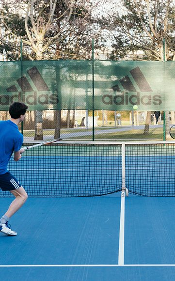 adidas employee playing tennis at adidas headquarter showing the workplace culture at adidas