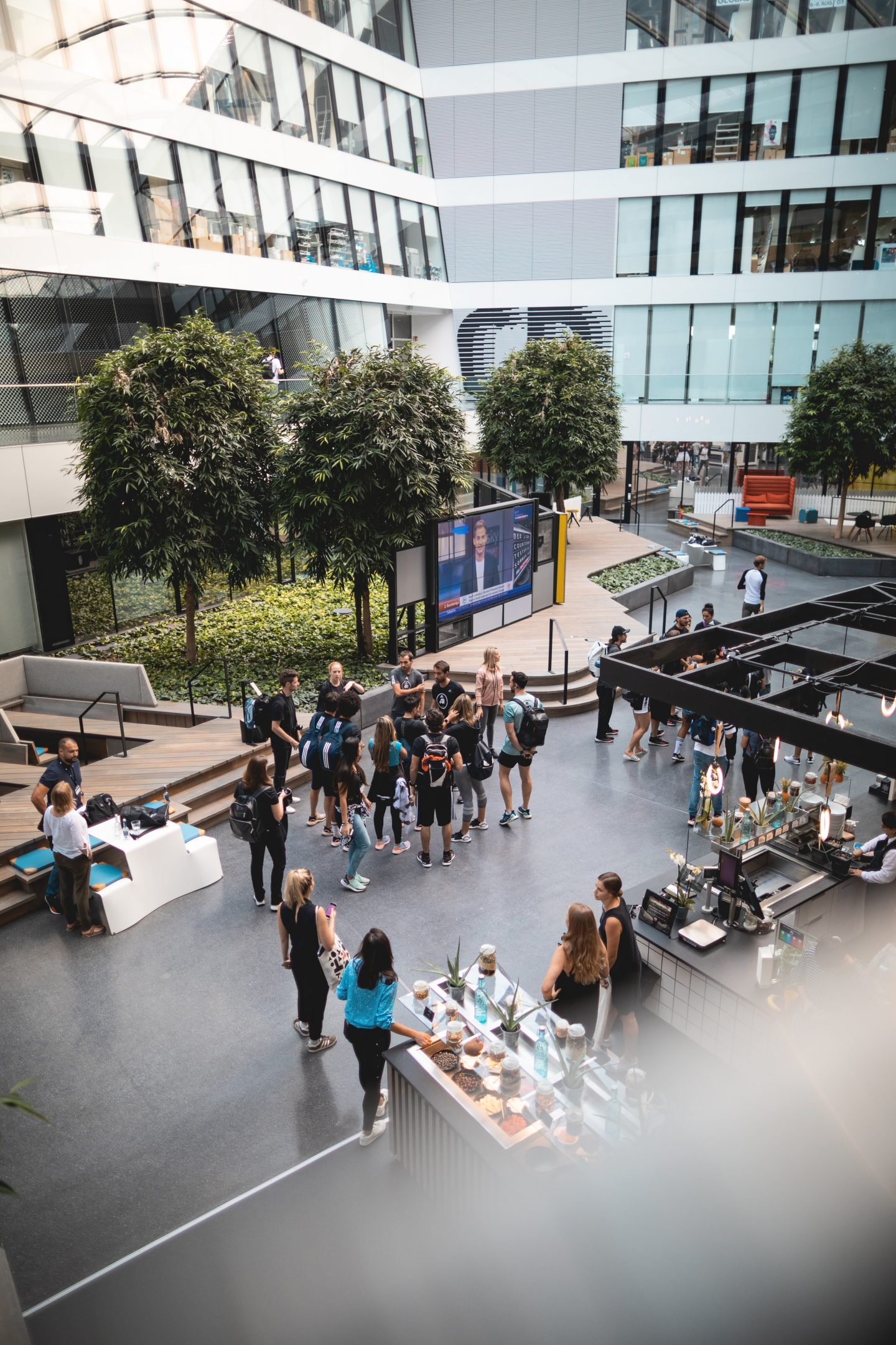 adidas athletes and employees at cafeteria atadidas headquarter Herzogenaurach showing the workplace culture at adidas with collaboration