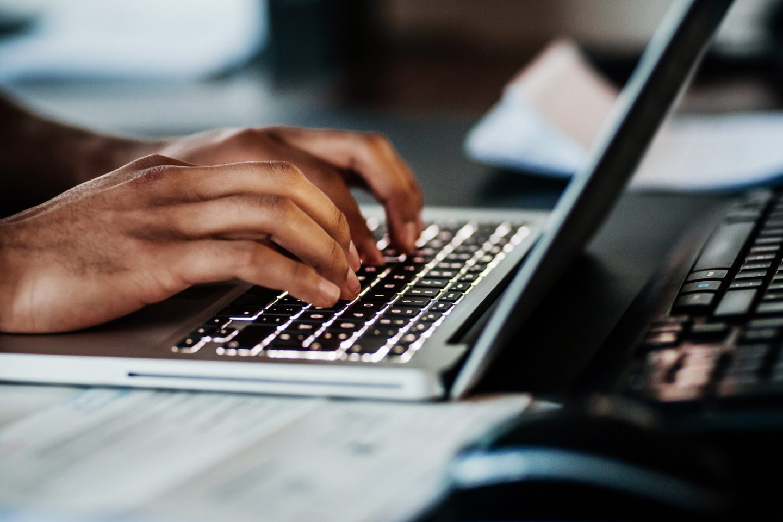 Close Up Of Man Typing On Laptop. student-athlete, studying, sports, social life, balance, mindset